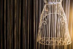 Rivesta di ferro il vestito su un fondo nero Immagine Stock