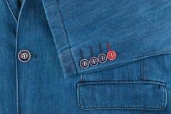 Rivestimento del denim di struttura con la tasca e le maniche Fotografie Stock Libere da Diritti