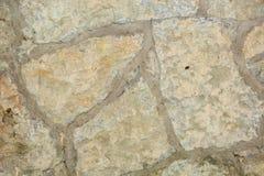 Rivestimento di pietra, struttura di pietra del recinto Fondo di pietra fotografie stock libere da diritti