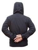 Rivestimento nero con le mani dell'uomo e del cappuccio isolate su backgroun bianco Fotografie Stock Libere da Diritti