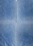 rivet blått papper arkivbild
