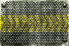 Rivet with black grille on metal plate and yellow line painted. Stock Photos