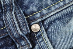 Rivet on a blue jeans Royalty Free Stock Photo