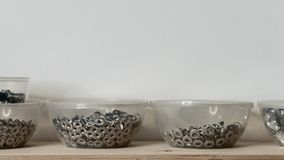 Rivet fasteners in containers. Rivet fasteners in plastic containers. Tanner`s workshop Royalty Free Stock Image