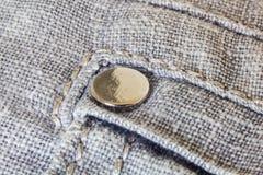 Rivet on gray trousers Stock Photos