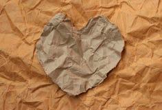 rivet hjärtapapper Arkivfoto