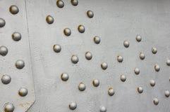 Rivet metal wall, techno background bridge fastener. Fragment Stock Photo
