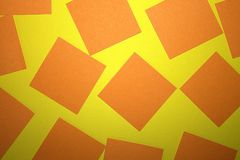 rivet papper orange yellow för bakgrund arkivfoto