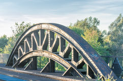 Riveted bridge arch. Riveted old arch of an old railway bridge Royalty Free Stock Photos