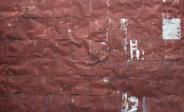 Riveted red metal sheet wall Royalty Free Stock Image