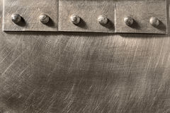 Riveted seam on the metal. Scratched sheet Stock Photography