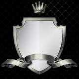 Riveted shield and silver ribbon. Royalty Free Stock Images