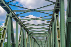 Riveted Steel Bridge. Former old riveted railway steel bridge for pedestrians and cyclists over the Ruhr in Essen Kupferdreh Stock Image