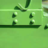 Riveted steel plates with green paint. Ing Stock Images