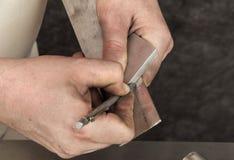 riveten för applikatortrycksprutametall nier seminariet Arkivfoto