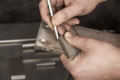 riveten för applikatortrycksprutametall nier seminariet Royaltyfri Bild