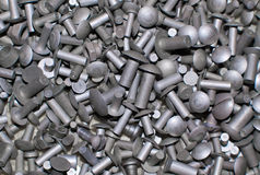 Rivets. Multitude of metal rivets shot Stock Photography