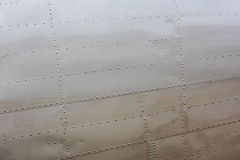 Rivets on aircraft skin. Rivet pattern on skin of classic aircraft (Douglas DC-3 Dakota stock photos