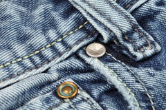 Rivets on blue jeans Royalty Free Stock Photography
