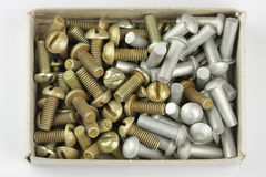 Rivets and bolts. Pile of rivets and bolts in the matchbox Royalty Free Stock Photography