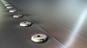 Rivets On Brushed Metal Perspective Stock Photo