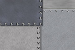 Rivets in brushed steel Royalty Free Stock Photo