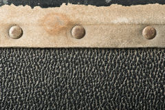 Rivets and leather parts from suitcase Stock Photos