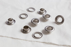 Rivets on light white cloth Stock Image