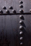 Rivets in metal. Stock Photos