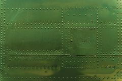 Rivets and Metal Background. Dark Green Painted. Metal Military Grade Backdrop royalty free stock photo