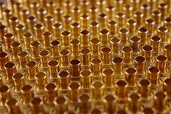 Rivets pour des vêtements de métal jaune Photographie stock libre de droits