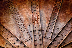 Rivets and on rusty metals stock photography