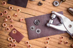 Rivets. Tailor workplace with pieces of leather and rivets Royalty Free Stock Photography
