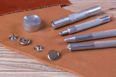 Rivets and tools on  leather.  Royalty Free Stock Photo