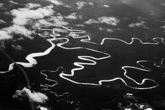 Rivières noires et blanches Photo stock