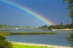 Rivier De Waal, River De Waal. Regenboog boven rivier De Waal, Rainbow above river De Waal stock photo