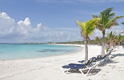Riviera Maya Mexico Beach. Empty white sand beach, ocean and palm trees in Mexico, Riviera Maya Royalty Free Stock Image