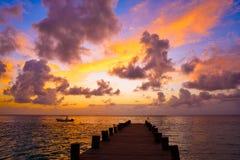 Riviera Maya pier sunrise in Caribbean Mayan. Mexico royalty free stock photos