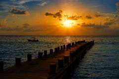 Riviera Maya pier sunrise in Caribbean Mayan stock photo