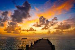 Riviera Maya pier sunrise in Caribbean Mayan. Mexico stock photography