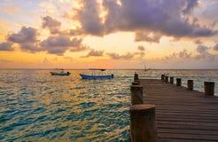 Riviera Maya pier sunrise in Caribbean Mayan. Mexico stock photos