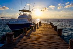 Riviera Maya sunrise boat at beach pier. Riviera Maya sunrise fishing boat at beach pier in Mayan Mexico royalty free stock image