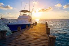 Riviera Maya sunrise boat at beach pier. Riviera Maya sunrise fishing boat at beach pier in Mayan Mexico stock photos