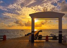 Riviera Maya sunrise pier Caribbean Mexico stock photo