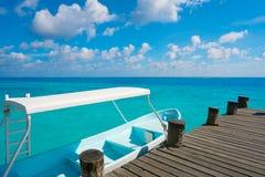 Riviera Maya wood pier and boats. In Mayan Mexico Stock Photo