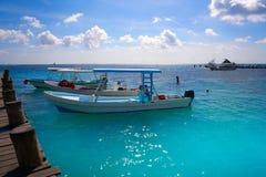 Riviera Maya wood pier and boats. In Mayan Mexico Stock Image
