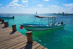 Riviera Maya wood pier and boats. In Mayan Mexico Royalty Free Stock Photo