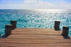 Riviera Maya wood pier Caribbean Mexico. Riviera Maya wood pier with Caribbean boats in Mexico stock photography