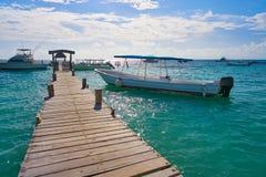 Riviera Maya wood pier Caribbean Mexico. Riviera Maya wood pier with Caribbean boats in Mexico royalty free stock photo