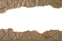 rivit sönder brunt papper Arkivfoto